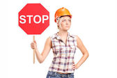 Female worker holding stop sign — Stock Photo