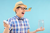 Man trapping butterfly in jar — Stock Photo