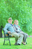 Mature man and woman relaxing — Stockfoto