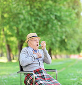 Senior man having asthma attack — Stock Photo