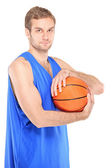 Basketball pro holding ball — Stock Photo