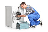 Plumber fixing washing machine — Stock Photo