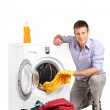 Young man doing laundry — Stock Photo #48518217