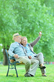Mature couple taking selfie — Stock Photo