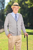 Gentleman with cane in park — Stock Photo