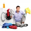 Confused young man doing laundry  — Stock Photo #48618241