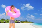 Boy standing with swimming ring — Stock Photo