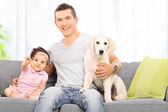 Father with daughter and puppy — Stock Photo