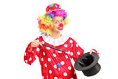 Female clown holding magician hat — Stock Photo