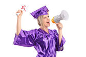 Graduate student speaking on megaphone — Stock Photo