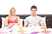 Couple lying together in bed — Stock Photo