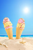 Ice cream stuck in sand — Foto Stock