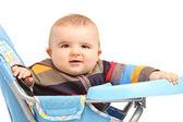 Baby boy in feeding chair — Stockfoto