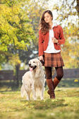 Girl with dog in park — Stockfoto