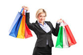 Businesswoman holding shopping bags — Stock Photo