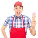 Cheerful vendor holding ice cream — Stock Photo