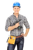 Male carpenter holding electric drill — Stock Photo