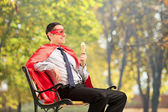 Superhero enjoying ice cream — Stock Photo