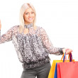 Fashionable woman holding shopping bags — Stock Photo #49672063