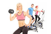 Three athletes exercising with fitness equipment — Stock Photo