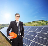 Engineer in front of solar panels — Stock Photo