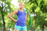 Female athlete holding hula hoop — Stock Photo