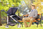 Grandfather and baby in stroller — Stock Photo