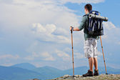 Hiker standing on mountain top — Stock Photo