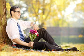 Man with bunch of flowers — Stock Photo