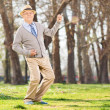 Senior man playing air guitar — Stock Photo #49916401