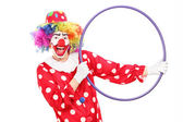 Male clown holding hula hoop — Stock Photo