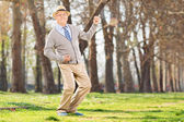 Senior man playing air guitar — Stock Photo
