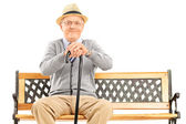 Senior gentleman sitting on bench — Stock Photo
