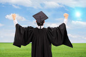 Male graduate gesturing happiness — Stock Photo