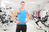 Male athlete posing in gym — Stock Photo