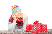 Woman next to Christmas present — Stock Photo