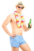 Guy holding bottle of beer — Stock Photo