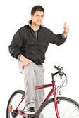 Man on bike giving thumb up — Stock Photo
