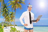 Businessman with mask holding laptop — Stock Photo