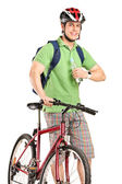 Guy with bike holding water — Stock Photo