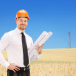 Male engineer holding construction plans — Stock Photo #51165081