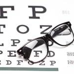 Glasses on eye chart — Stock Photo #51165133