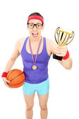 Basketball player holding golden trophy — Stock Photo