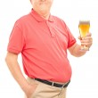 Senior holding pint of beer — Stock Photo #51450603