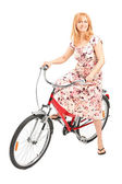 Mature lady seated on bicycle — Stock Photo