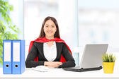 Businesswoman in superhero costume   — Stock Photo