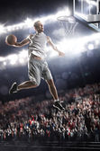 Basketball player in action — Stock Photo