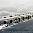 Snow and ice crystals on a guard rail — Stock Photo #45860977
