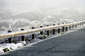 Snow and ice crystals on a guard rail  — Stock Photo