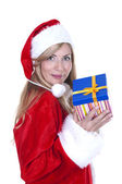 Woman dressed as Santa and holding a present — Stock Photo